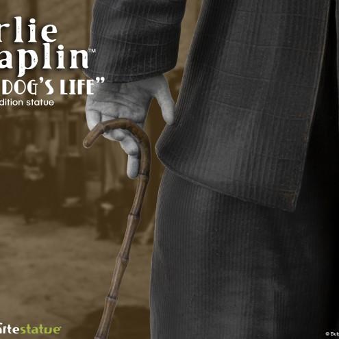 Scultura di Charlie Chaplin A Dog's Life dettaglio bastone